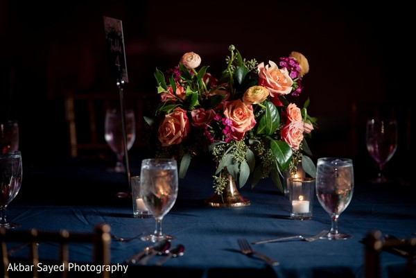 Pink and peach roses table centerpiece decoration.