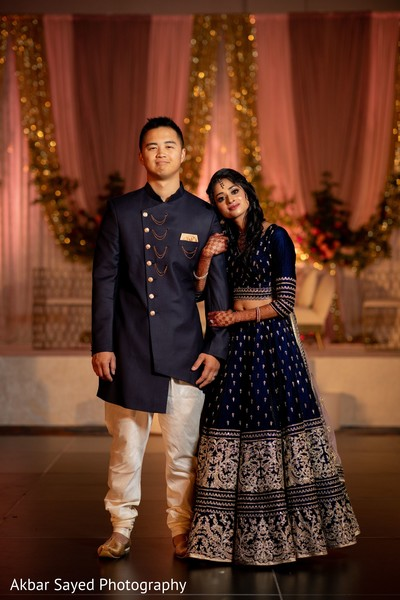 Indian couple posing at reception venue.