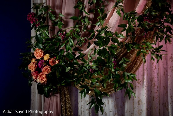Orange, pink and yellow roses for wedding reception decoration.