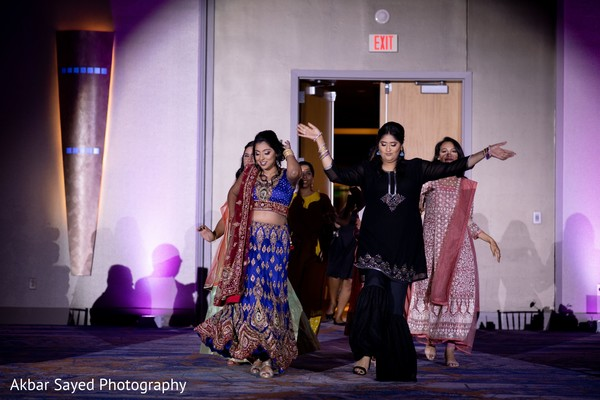 Indian Bridal Party walking in to wedding reception.