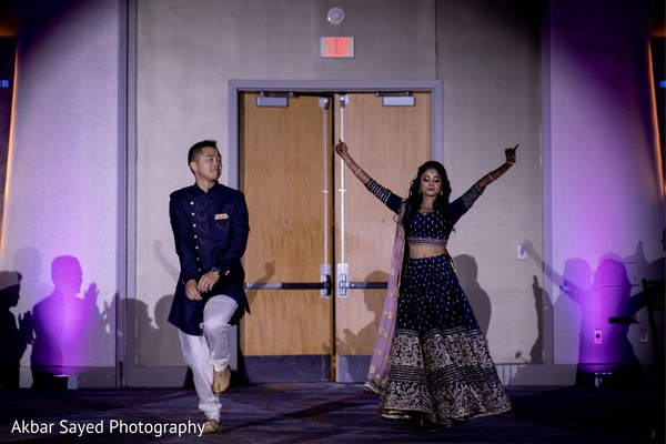 Indian bride and groom making their entrance to reception.