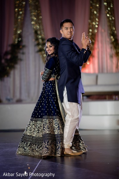 Indian bride and groom at reception choreography.