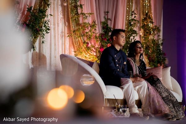 Indian couple enjoying their wedding reception party.