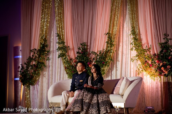 Indian bride and groom at reception stage capture.