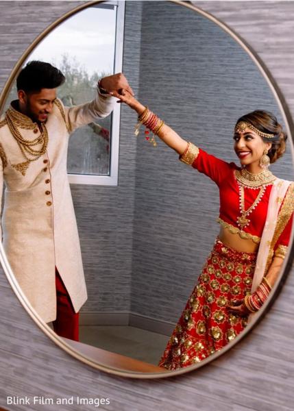Indian groom having a good look of his Indian bride