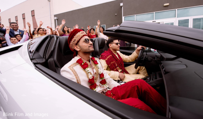 Indian groom in the sports car during the Baraat