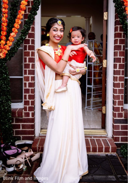 Indian bride carrying a baby