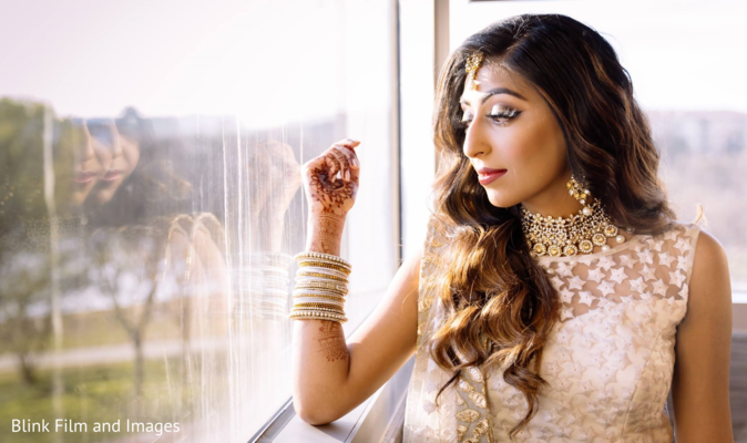 Indian bride looking out of the window