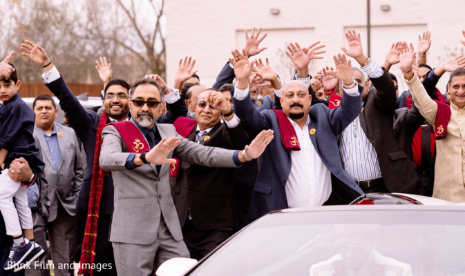 Indian relatives dancing behind the Baraat car