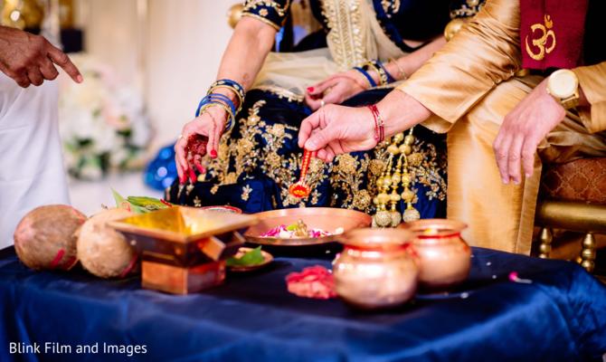 Indian relatives preparing the tumeric paste