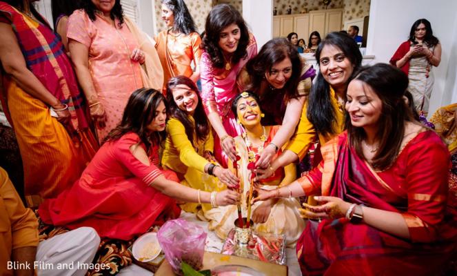 Several Indian relatives applying tumeric paste on Maharani