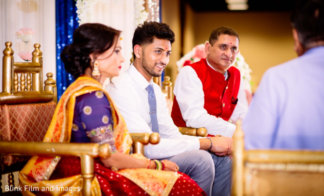 A close up to the Indian groom and his relatives on stage