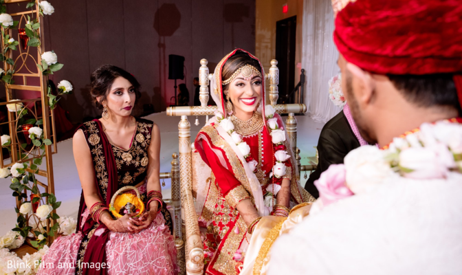 Maharani smiling to her Indian groom across the wedding stage