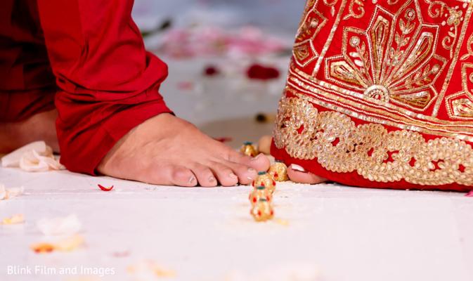 Indian couple stepping on nuts during the ceremony