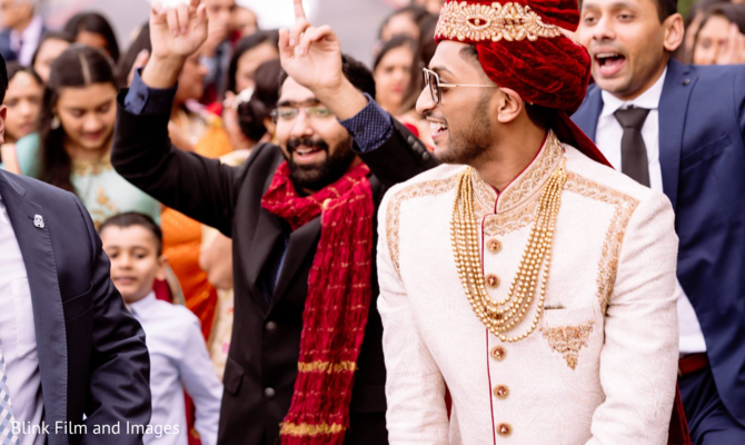 Indian relatives dancing behind the Indian groom during Baraat
