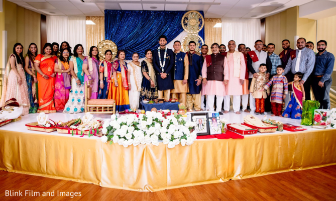 A family picture on a decorated stage