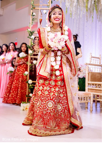 Maharani smiling while holding her bouquet
