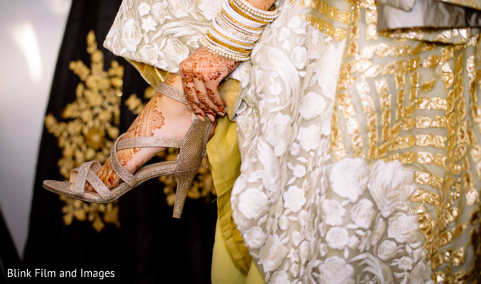Indian bride putting on her shoes
