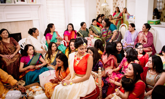 Indian bride and Indian relatives sitting before the celebrations