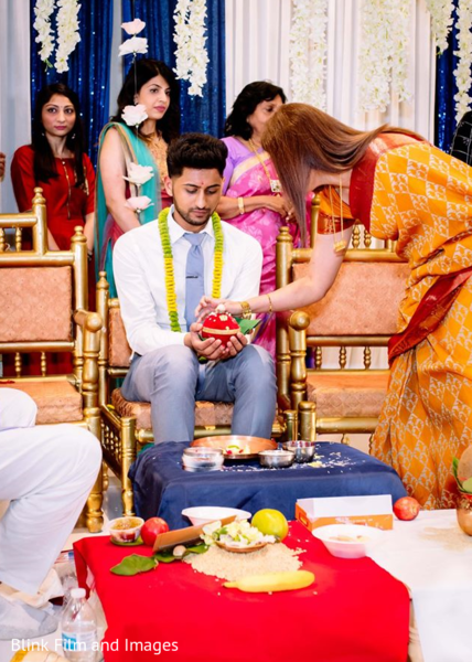 Indian groom receiving a spherical object