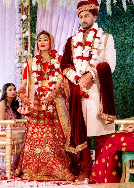 Indian couple stand during the ceremony