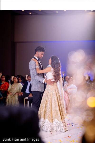 Indian newlyweds dancing during the reception