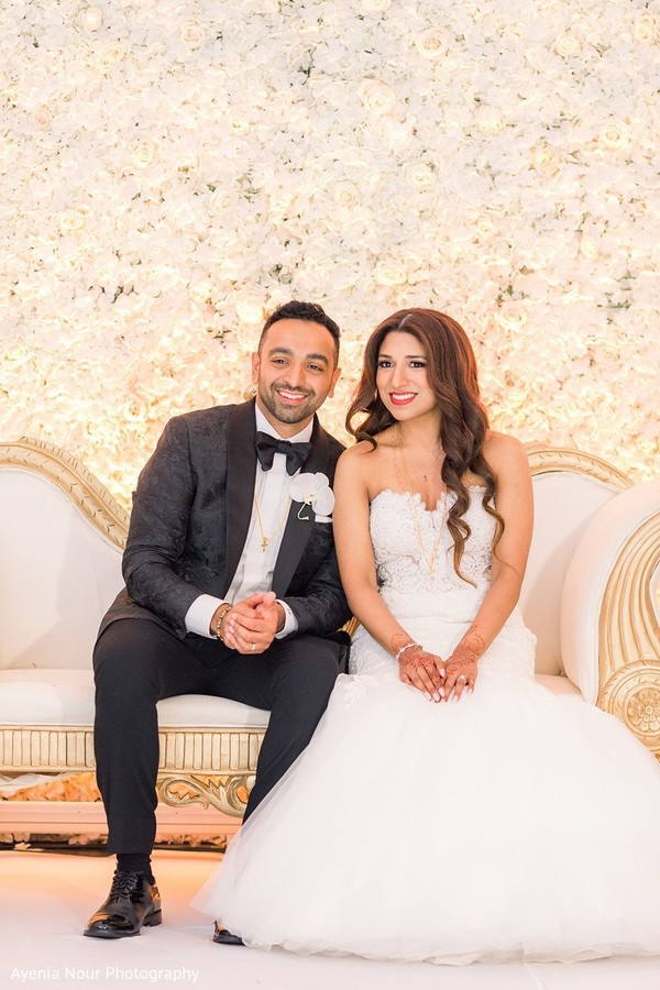 Indian couple enjoying their wedding reception.