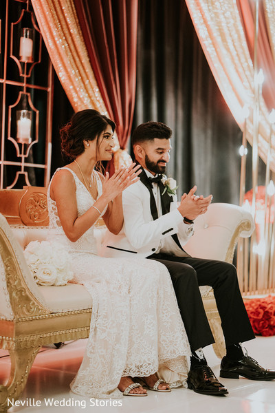Indian bride and groom at their wedding reception stage.