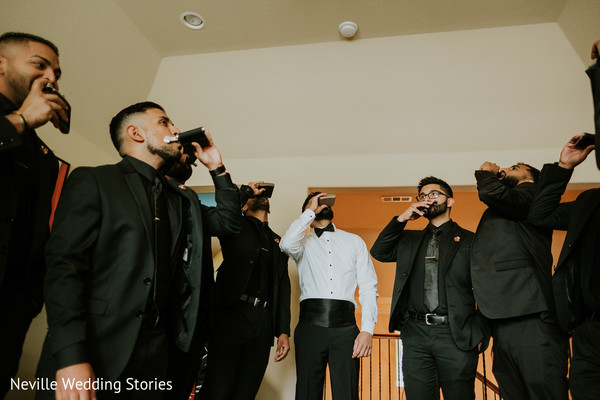 Indian groom and groomsmen having a toast on Pocket Flask.