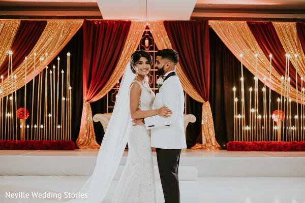 Maharani and raja posing on their white wedding outfits.