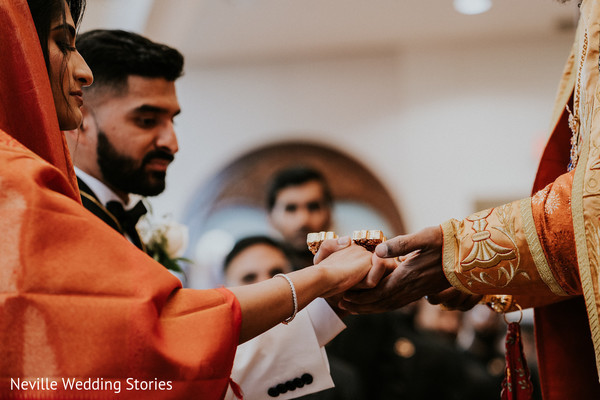Indian couple joining hands at Christian Indian wedding ritual.