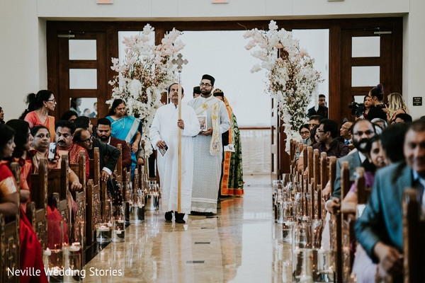 Indian priests walking down the aisle.