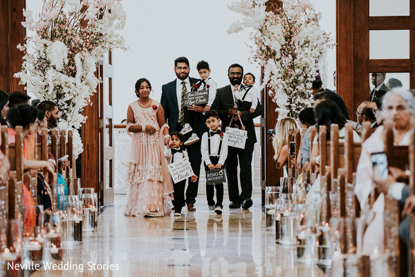 Indian page boys walking in down the ceremony aisle.