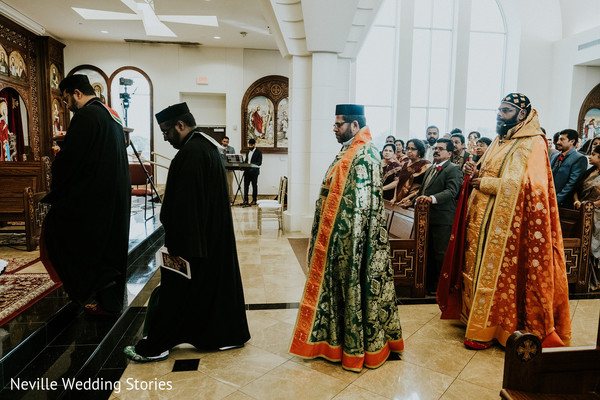 Christian Indian wedding priests making their entrance to church.