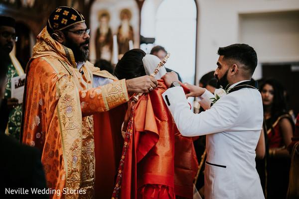 Indian bride getting her orange sacred veil ritual.