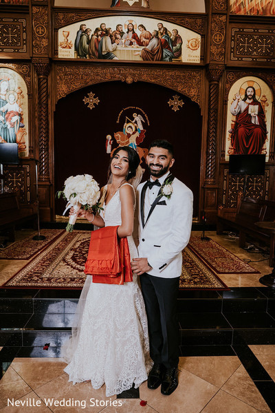 Indian couple posing inside wedding Christian Church.