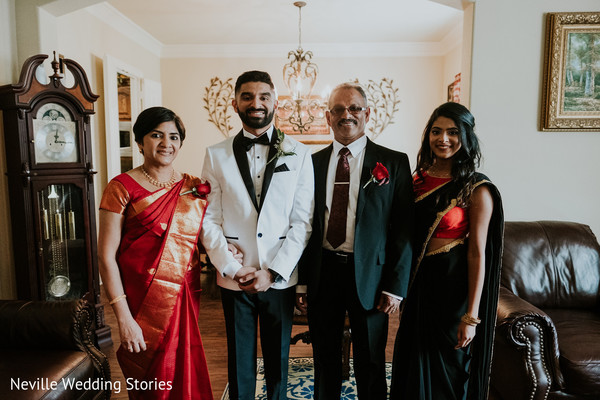Indian groom posing with family capture.