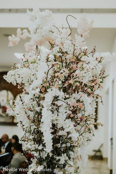 Indian wedding white and peach flowers decoration.