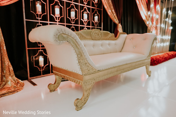 Indian wedding stage golden and ivory sofa.