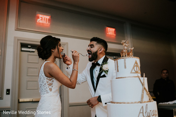Indian couple sharing cake moment.