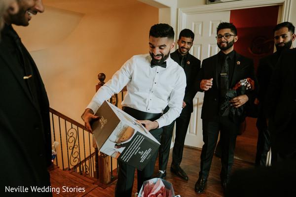 Indian groom receiving a present capture.