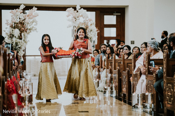 Indian flower girls walking down the aisle.