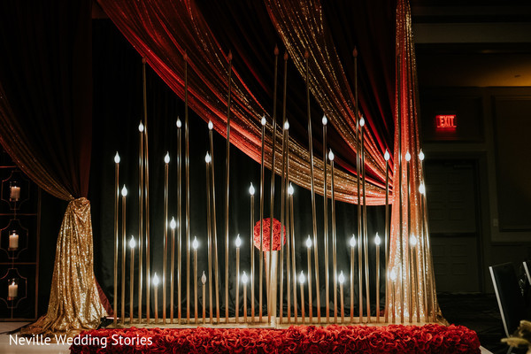 Indian wedding red and golden  draping, lights and flowers decoration.