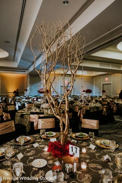 Golden Indian wedding table centerpiece branch decor.