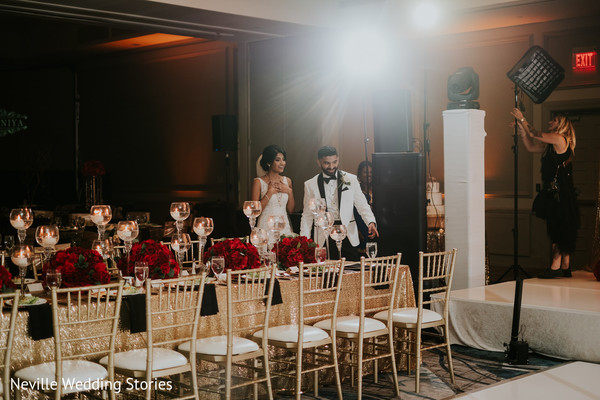 Indian couple walking around wedding reception.