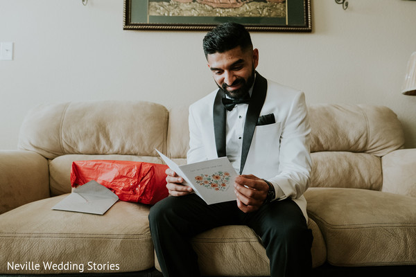 Indian groom reading his bride's postcard.