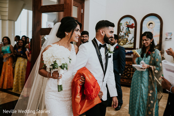 Indian couple at the end of Christian wedding ceremony.