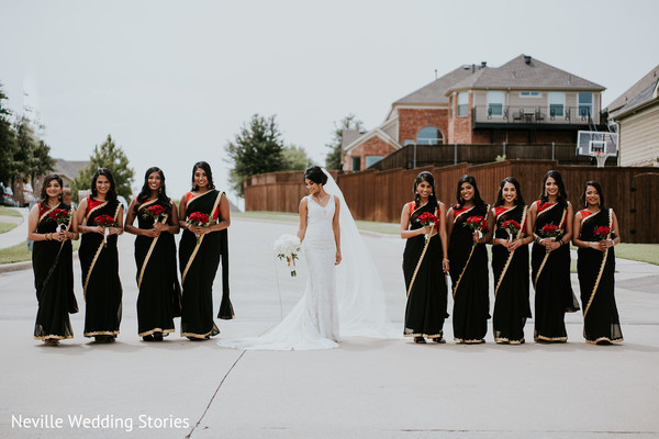 Indian bride in the middle of bridesmaids photo session.