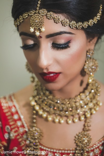 Indian bride showing her make up and jewelry