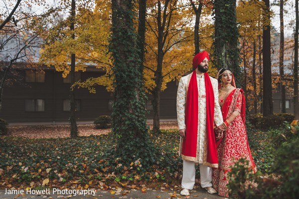 Indian bride clinging to her Indian groom in the forest